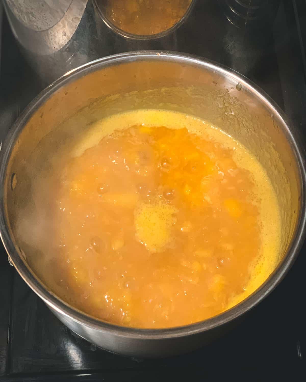 boiling the peach jam