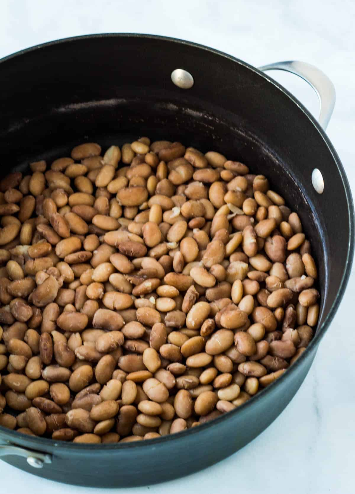 cooked pinto beans in a pot