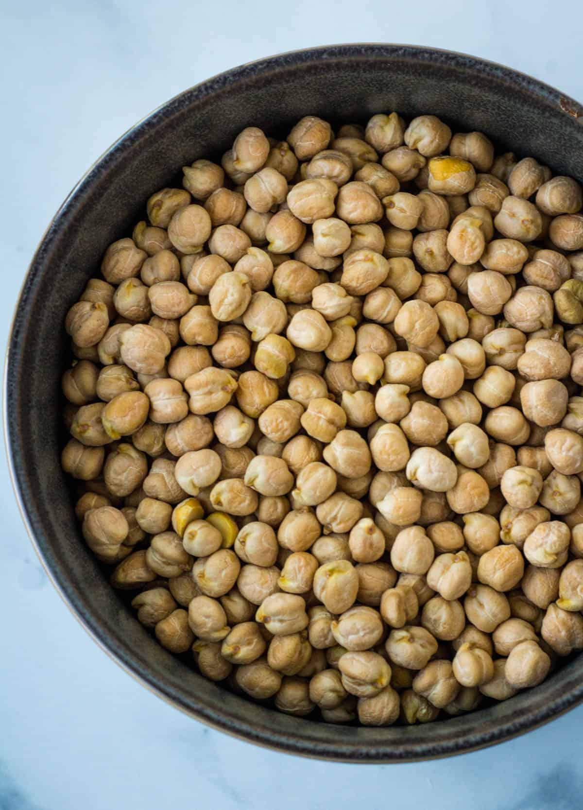 a bowl of dried garbonzo beans, also known as chickpeas