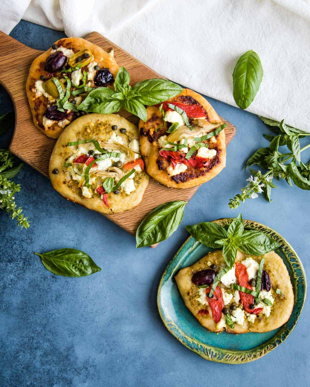 mini sourdough appetizer pizzas on a cutting board