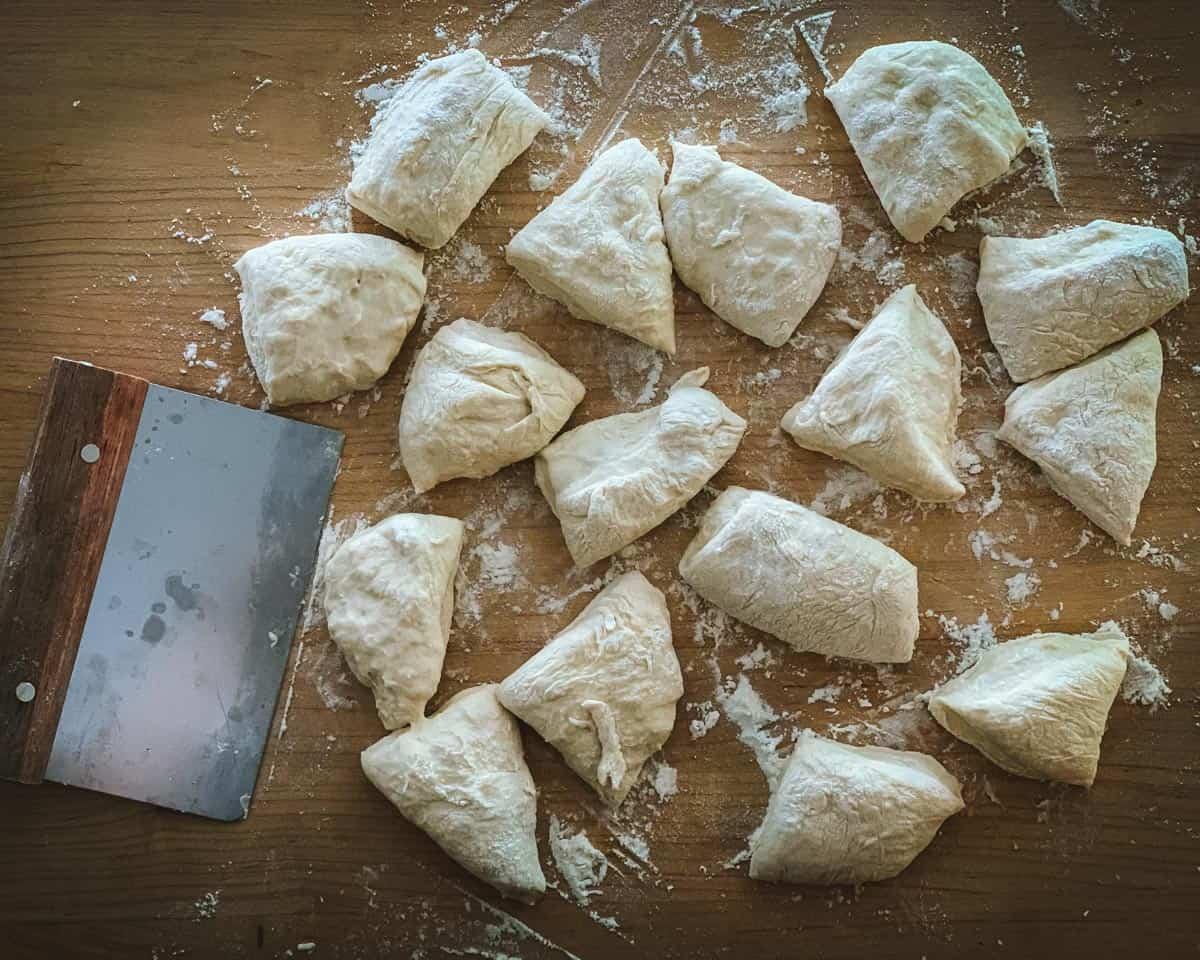 cutting the mini sourdough doughs into small pieces