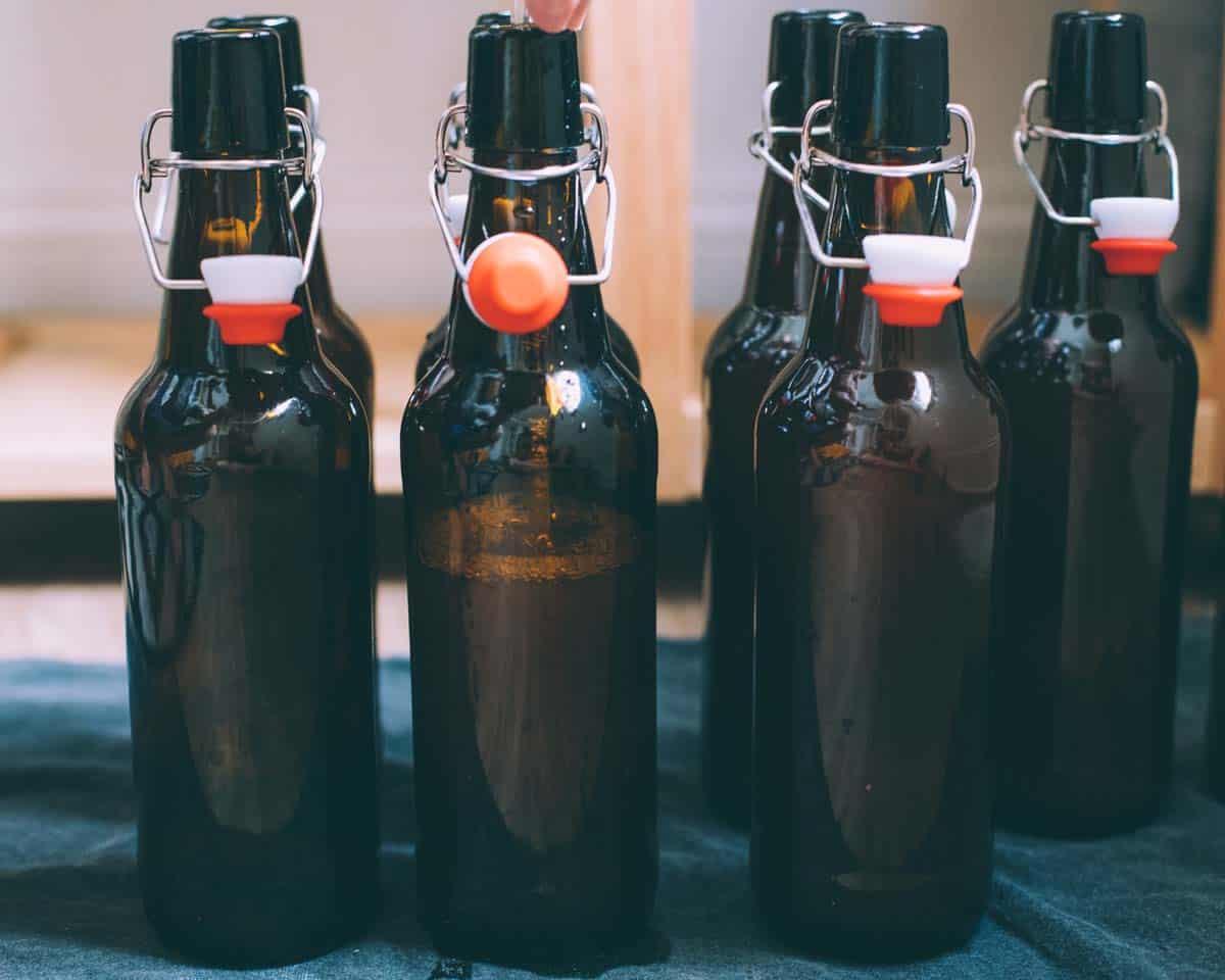 bottles being filled with hard cider