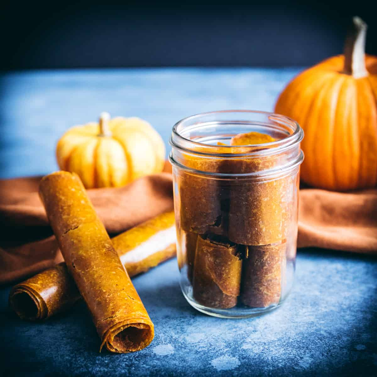 pumpkin leather rolls on a table and in a jar