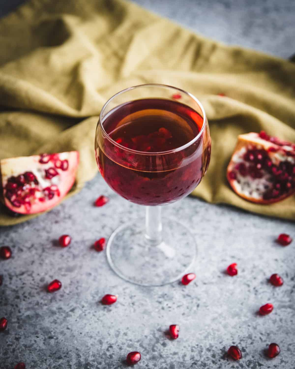top view of a glass of red pomegranate wine