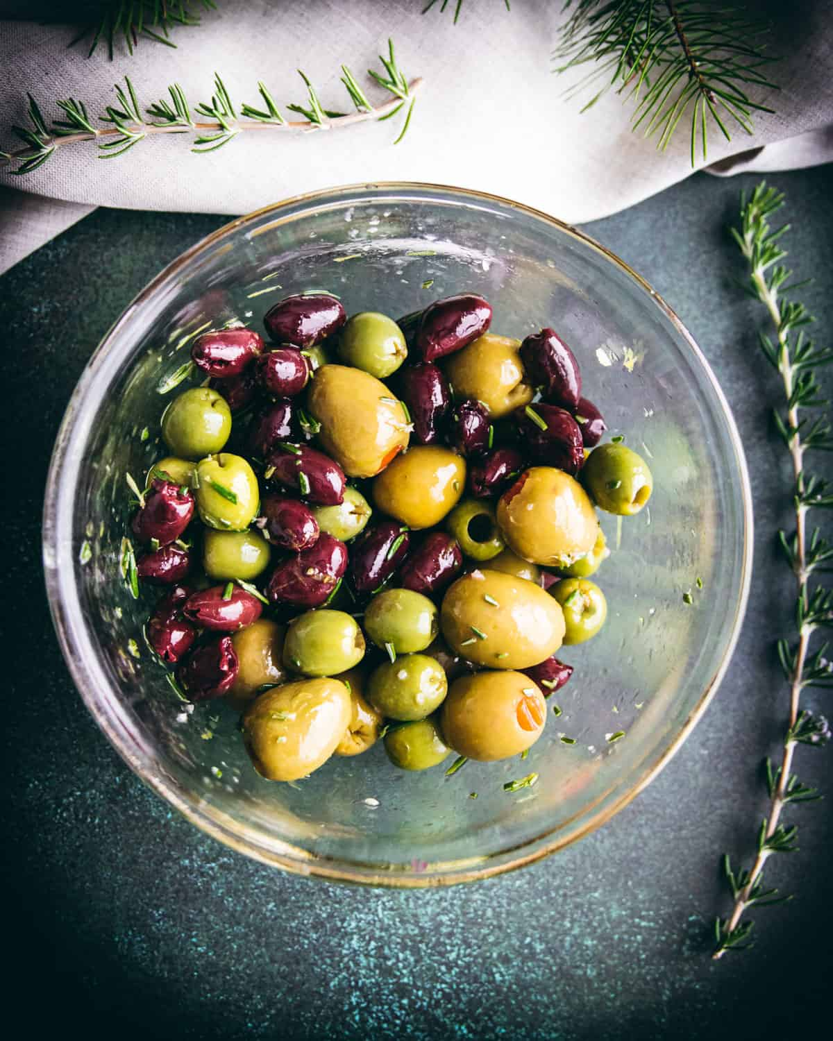 a variety of olives and other ingredients mixed together in a bowl