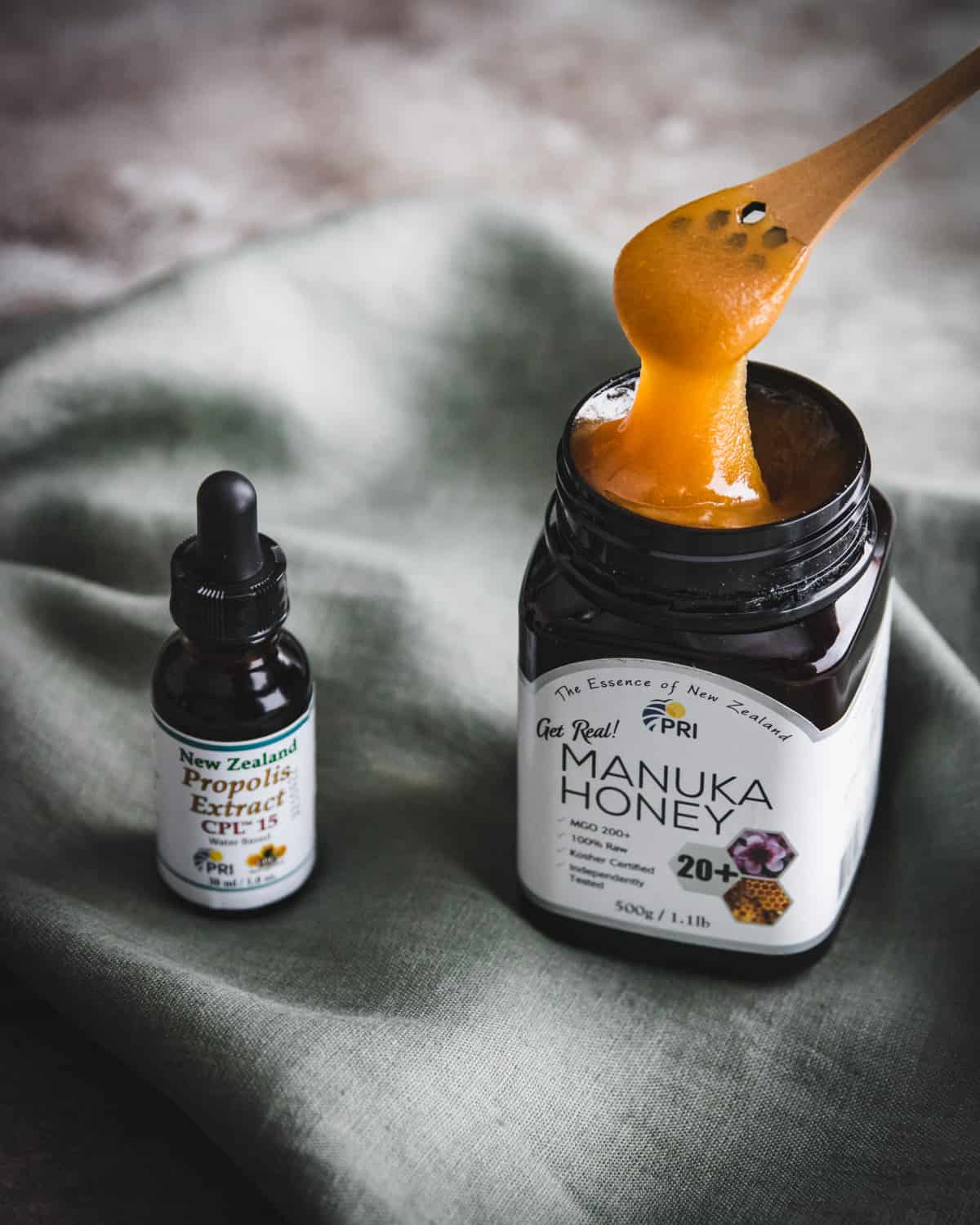 a bottle of propolis extract and a jar of manuka honey from PRI