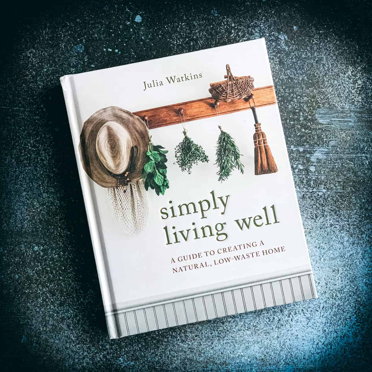 simply living well book by julia watkins on a dark blue background
