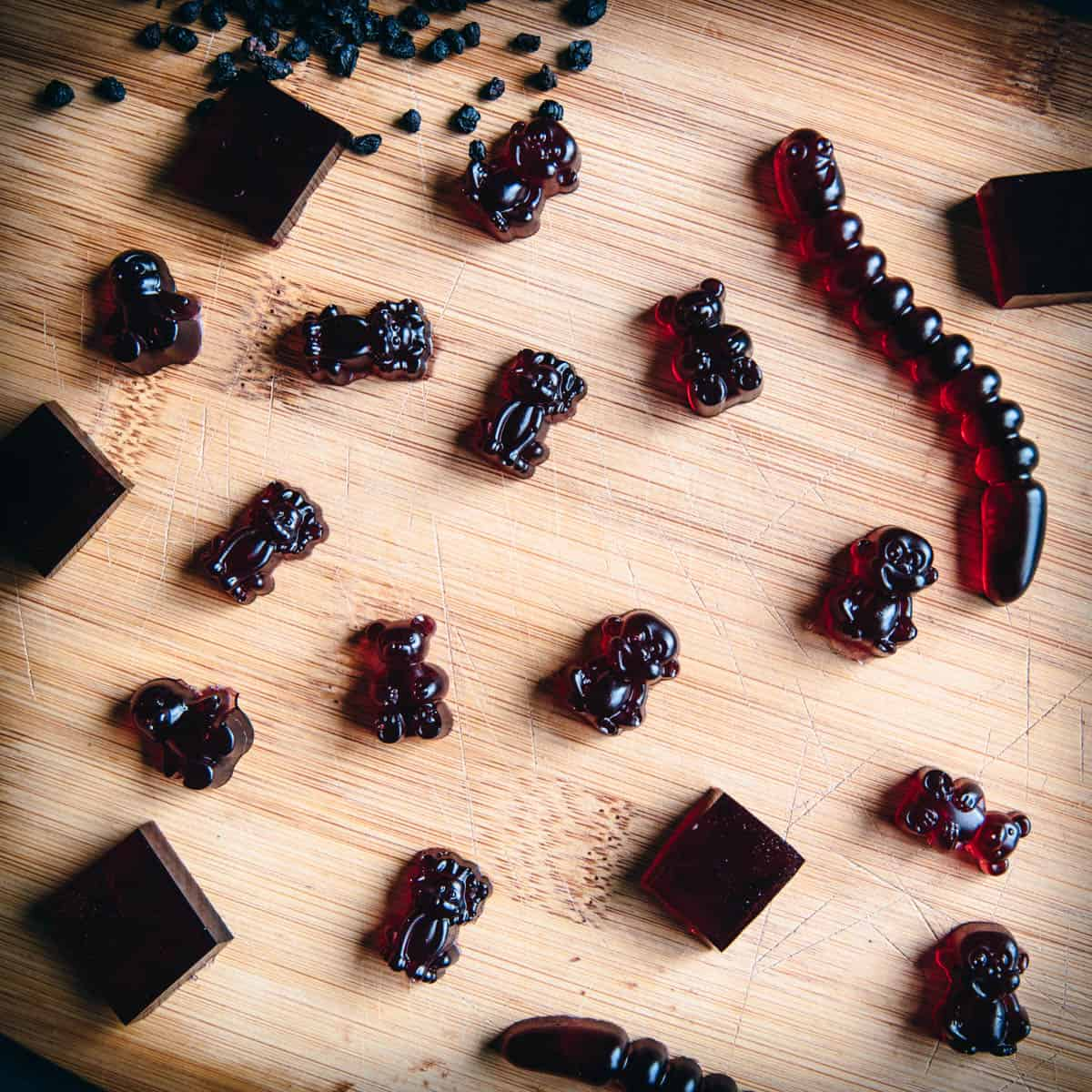 close up of elderberry gummies on a wooden cutting