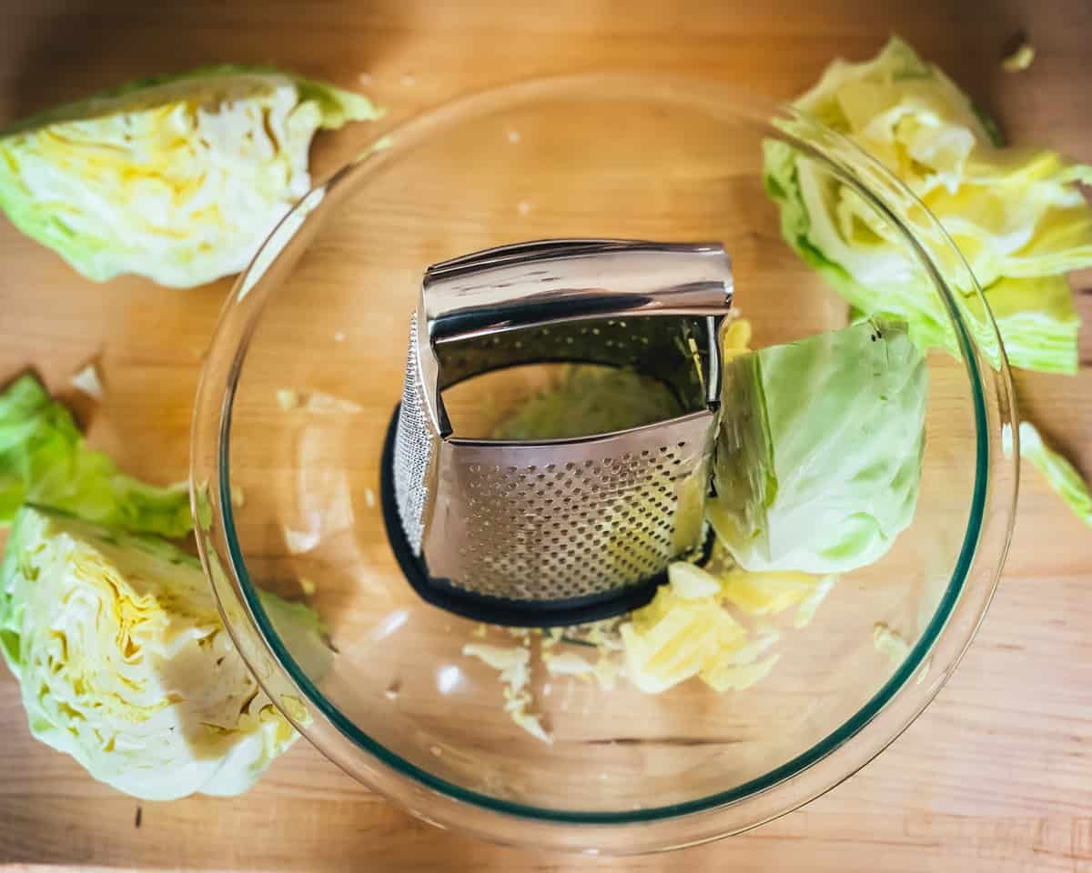 shredding the cabbage with a cheese grater