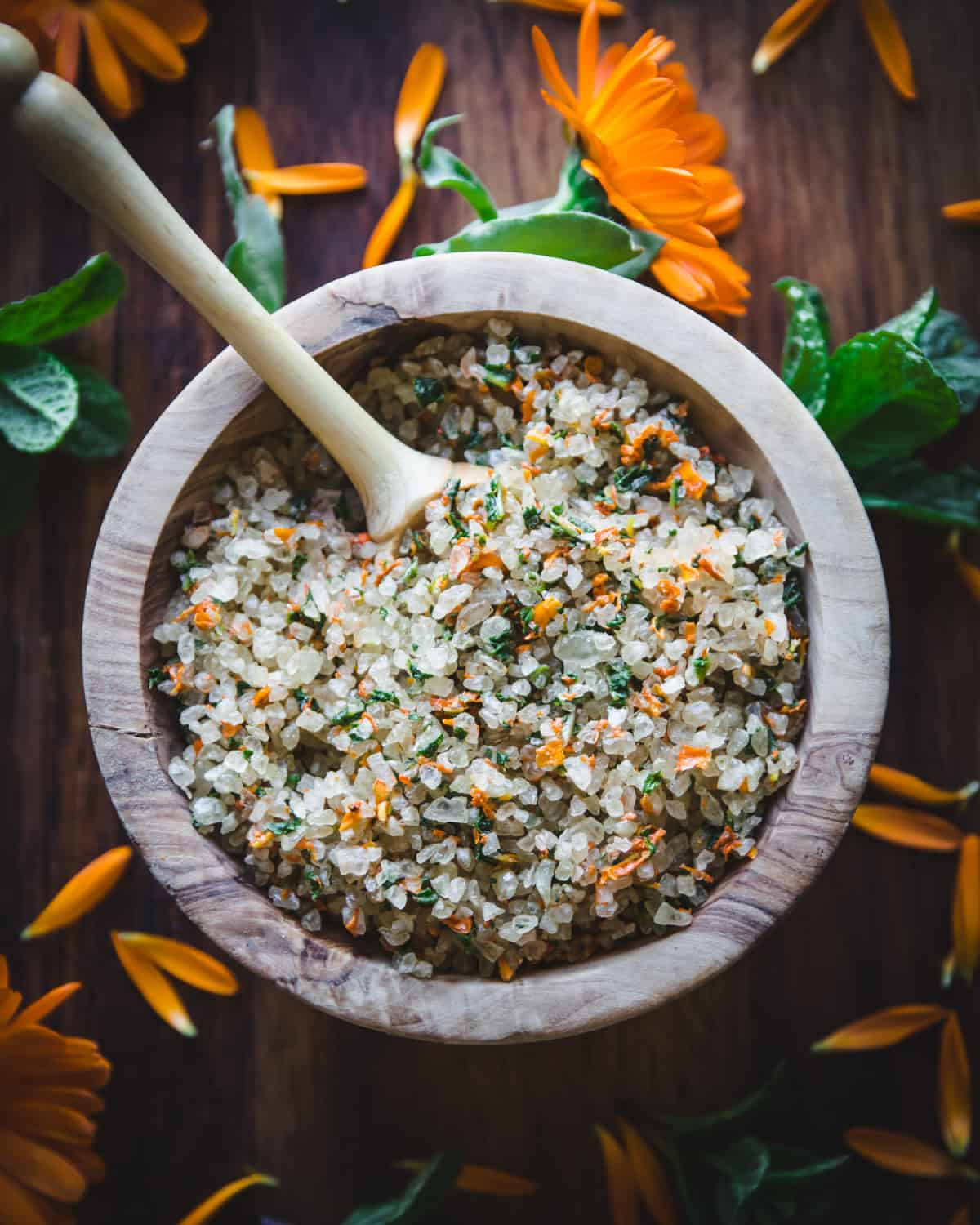 top view of a bowl of herbal bath salt with calendula and mint