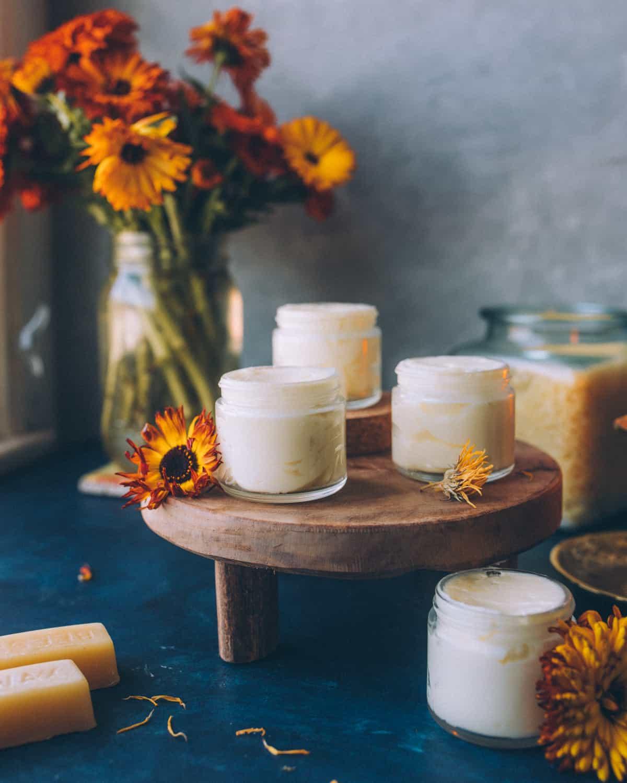 small glass jars of calendula cream