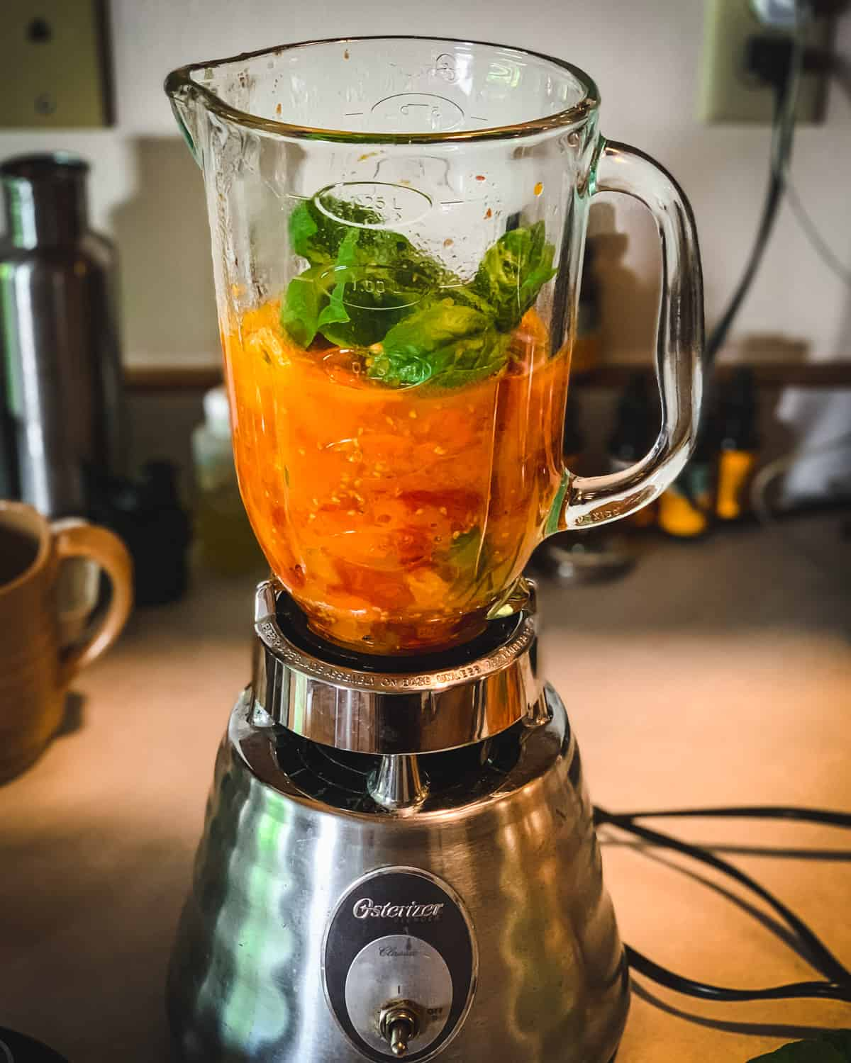 roasted tomates and basil in a blender
