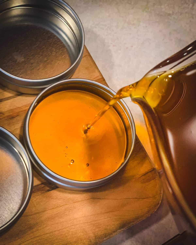pouring the salve mixture into a tin