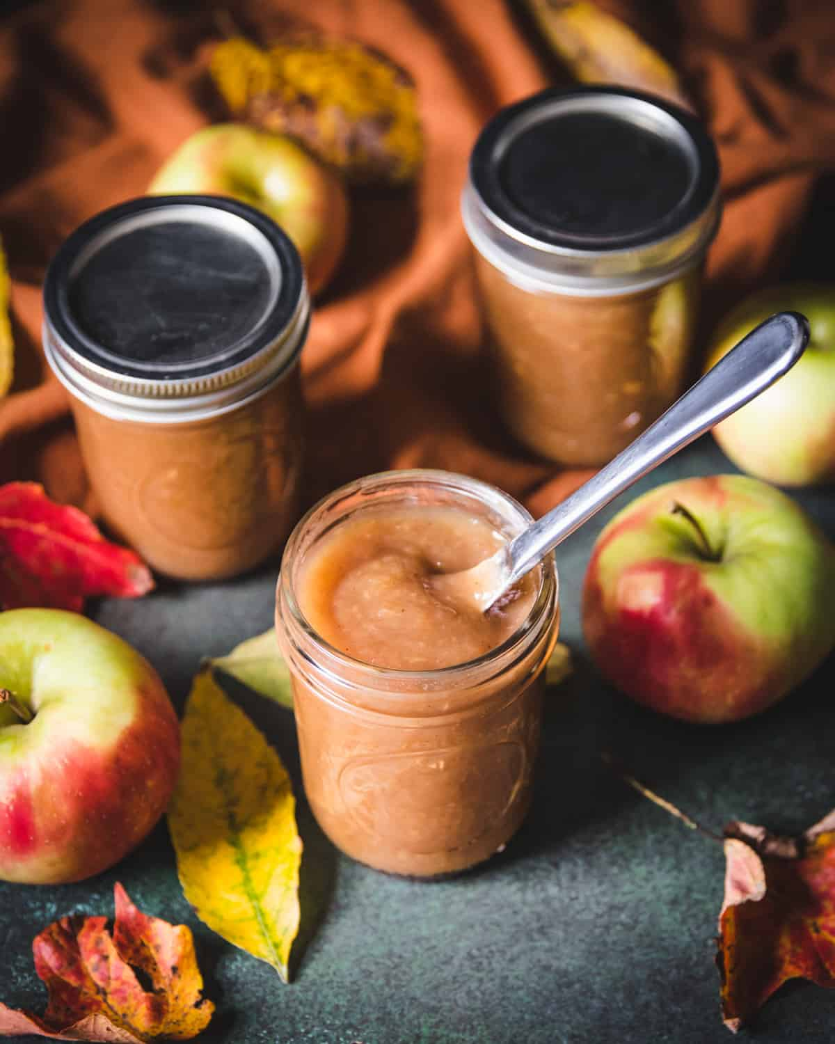 a jar of spiced apple butter with a knife