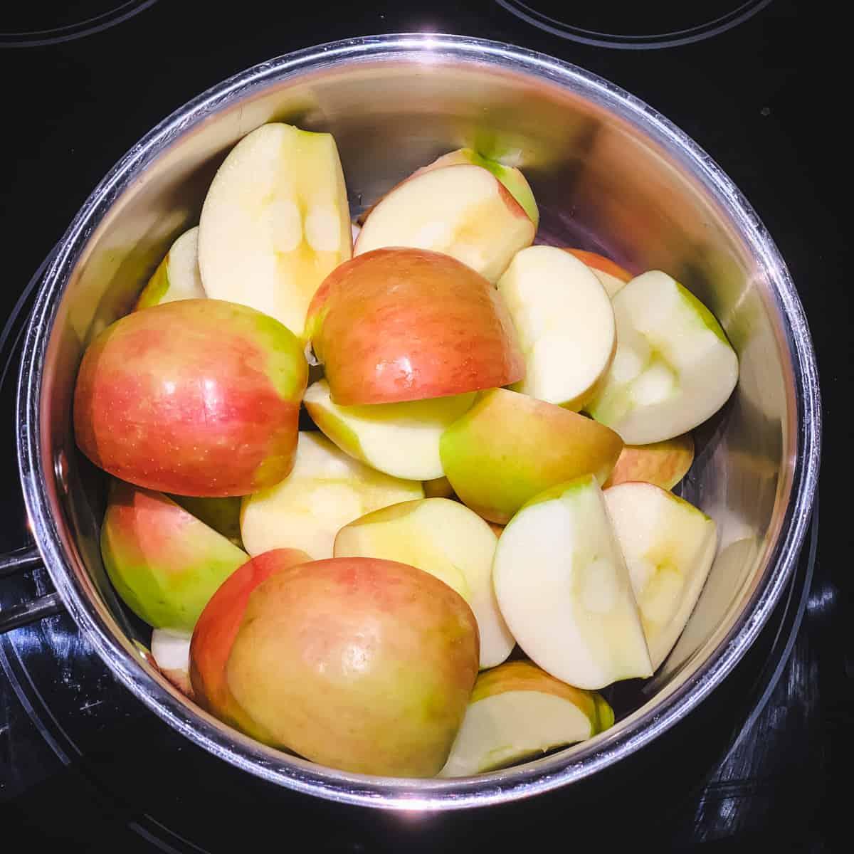 a pot of fresh quartered honeycrisp apples with the skins on
